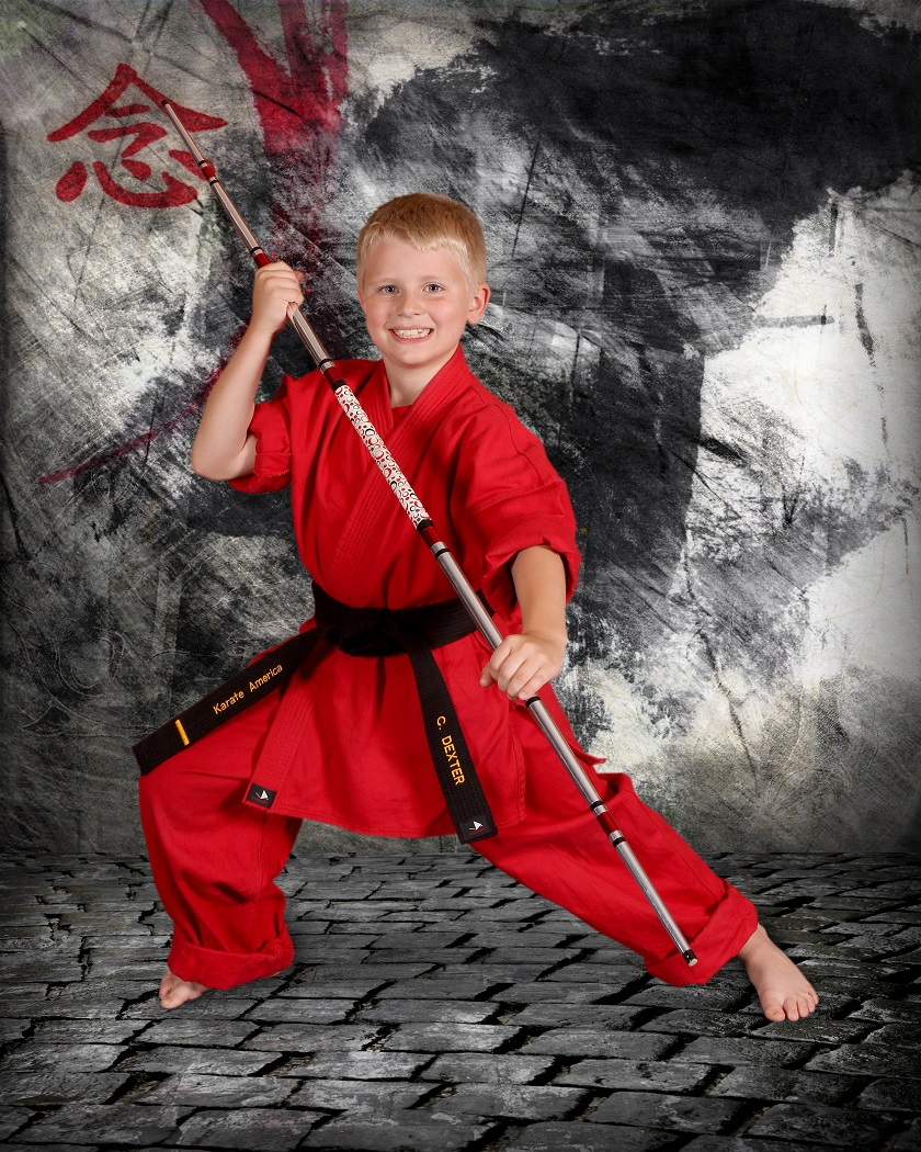 Confident Karate Kid with bo staff